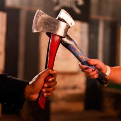 hands holding axes at BATL - Backyard Axe Throwing League - in Kitchener