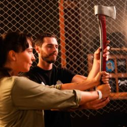 instructor helping a woman throw an axe at BATL - Backyard Axe Throwing League in Kitchener