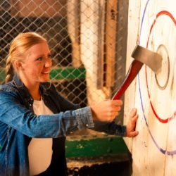 woman retreiving her ave from a target at BATL - Backyard Axe Throwing League in Kitchener