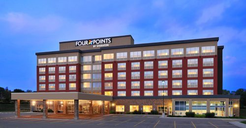 Exterior shot of the Four Points by Sheraton Cambridge-Kitchener at dusk