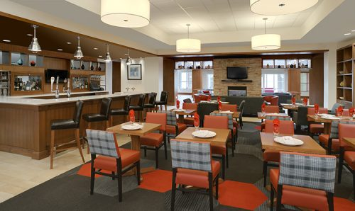 Restaurant seating and the bar at the Four Points by Sheraton Cambridge Kitchener