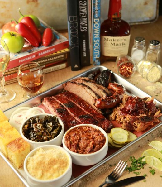 A spread of barbeque food and sides at The Lancaster Smokehouse