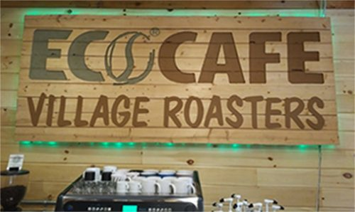 Signage for EcoCafe Village Roasters