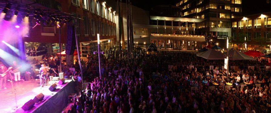 Night shot of the stage and crowd at TD Kitchener Blues Festival