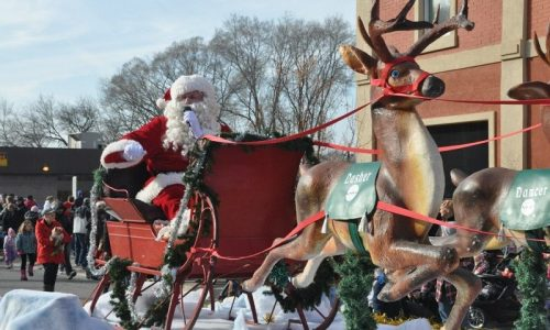 Santa Claus riding a float with a reindeer at the Hespeler Santa Claus Parade