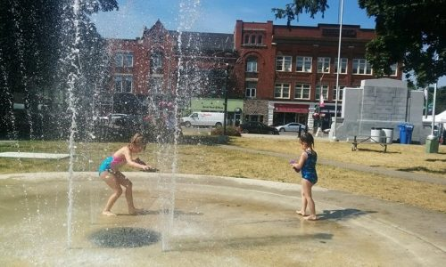Two young children playing in the Preston Towne Centre Summer Spray Pad
