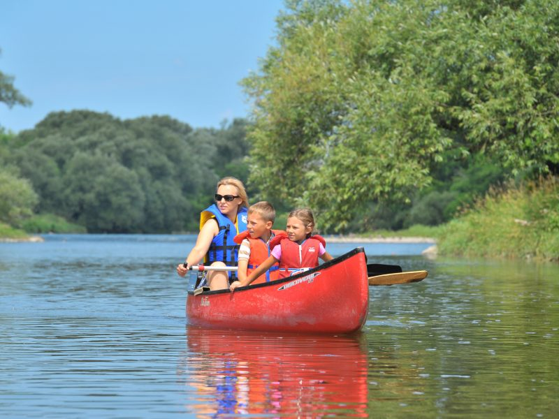 Family canoeing on the Grand River
