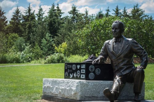 statue of Lester B. Pearson seated on a platform and in bare feet