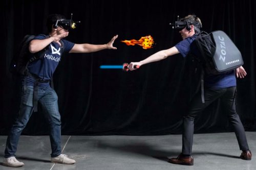 two gamers in virtual reality equipment playing at Mirage VR