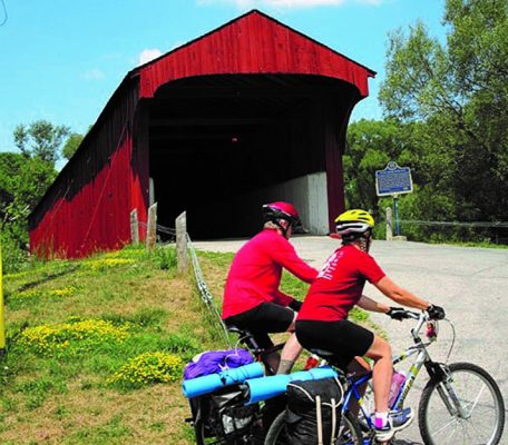 two cyclists at the Kissing Bridge in West Montrose