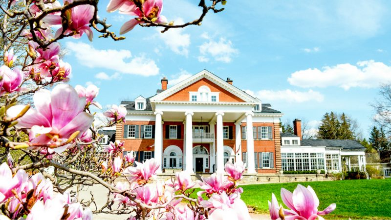 Exterior shot of Langdon Hall with Magnolia tree blossoms in the foreground