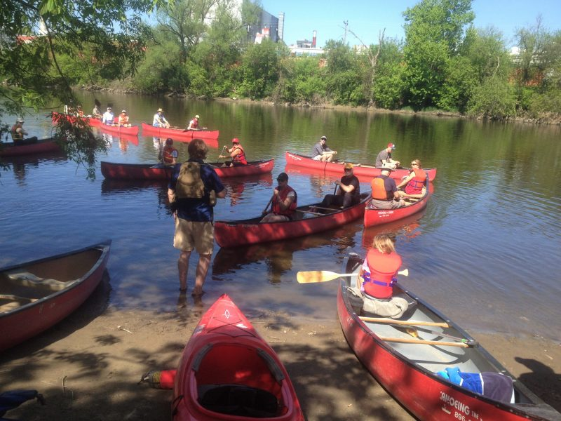 group of people canoeing on the Grand River with Canoeing the Grand