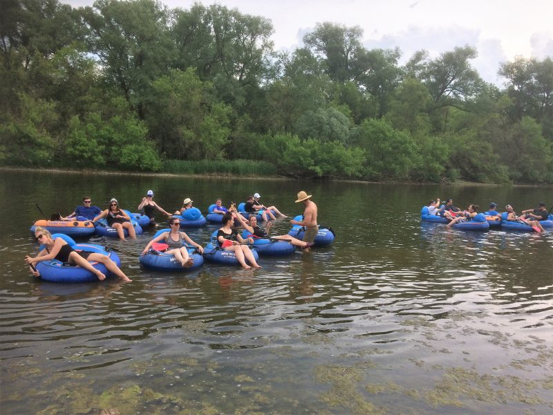 a group of people in tubes on the Grand River
