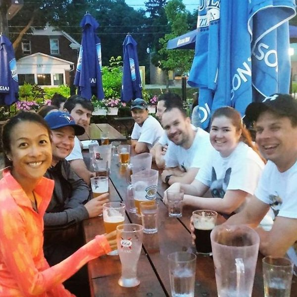 Group of friends enjoying beer on the outdoor patio at McMullen's bar in UpTown Waterloo, Ontario