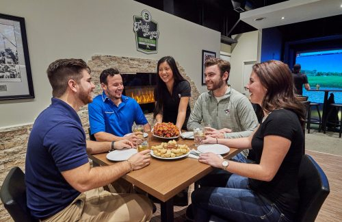 couples enjoying a meal at Players Indoor Golf & Sports Bar