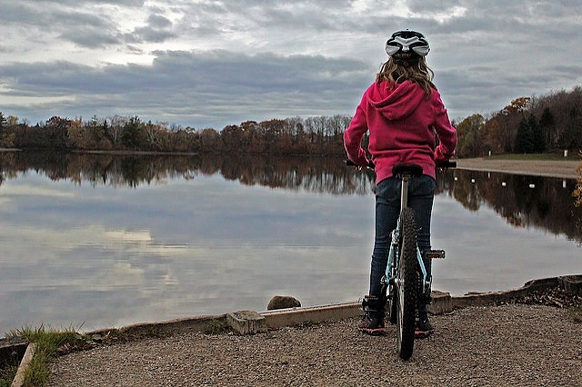 young cyclist on the beach at Shade's Mills, GRCA