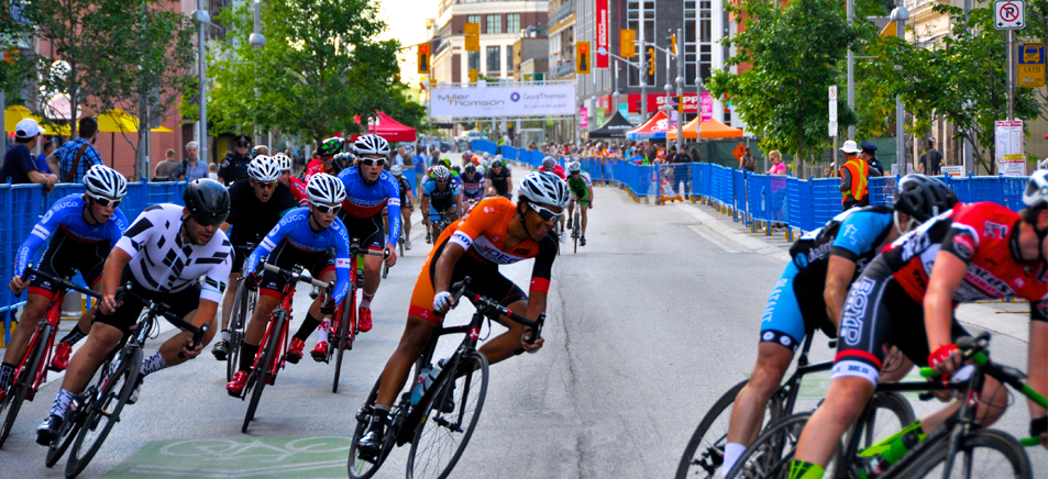 cyclists competeing in the Kitchener Twlilight Grand Prix cycling race in downtown Kitchener