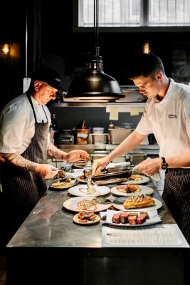 chefs working in the kitchen at The Rich Uncle Tavern