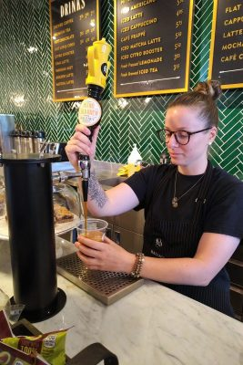 pouring a cold nitro coffee at Balzacs in The Tannery