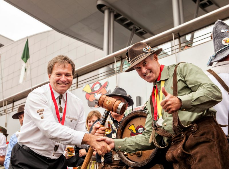Alfred Lowrick and Ron MacLean tap the keg at the 2015 KW Oktoberfest opening ceremonies