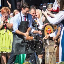 Prime Minister Justin Trudeau taps the keg at the opening of KW Oktoberfest 2017