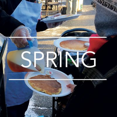 A man pouring syrup on pancakes at the Elmira Maple Syrup Festival - Things to do in Waterloo Region - Spring