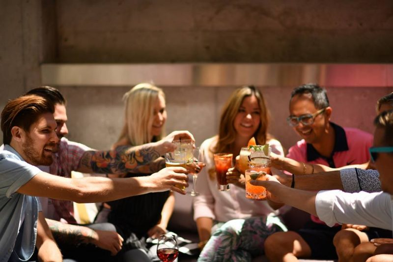 group of friends enjoying drinks on the patio at Proof Lounge in UpTown Waterloo