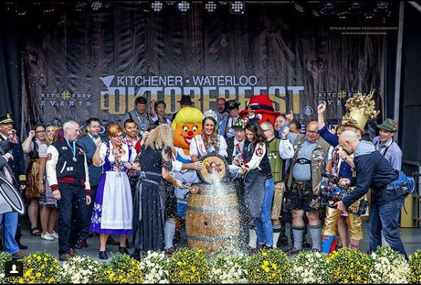 tapping the keg to open the 2018 KW Oktoberfest celebrations