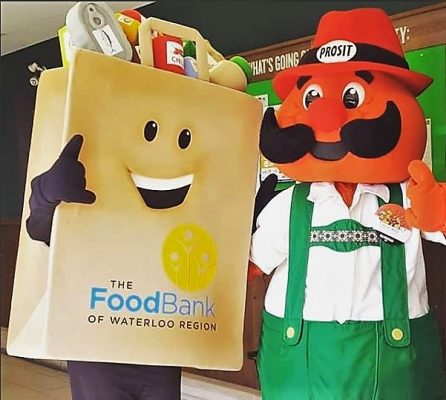 Phil the Food Bank mascot and Onkel Hans together at the Onkel Hans Food Drive
