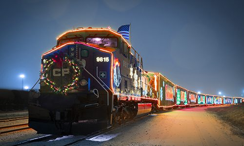 the CP Holiday Train lit up at dusk