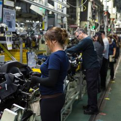 Workers assembling parts at the Toyota Motor Manufacturing Company Plant