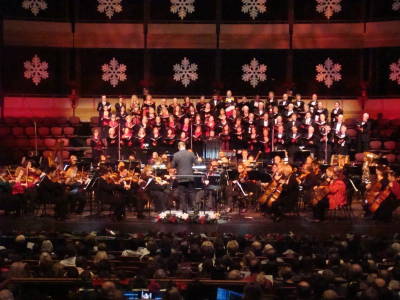 KW Symphony performing on a decorated stage at Yuletide Spectacular