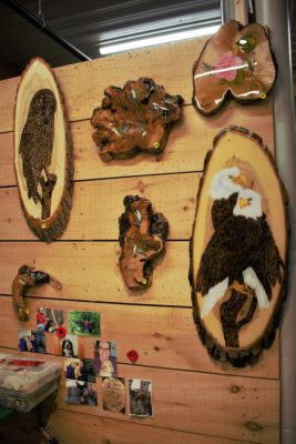 animal and nature paintings done on wood by artist Angus Burns of White Wolf & Friends at the St. Jacobs Farmers' Market