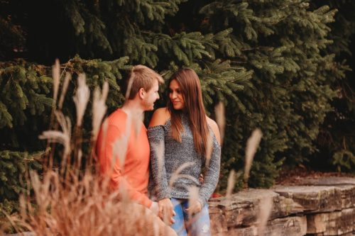 intimate photo of a young couple outdoors - photo by Photography from the Soul