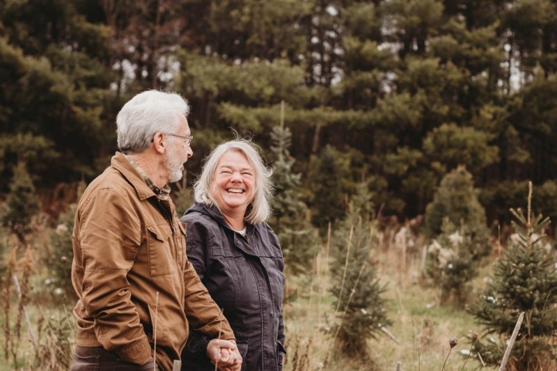 happy older couple walking int he fall outdoors - photo by Photography from the Soul
