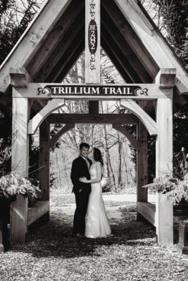 bride and groom at the entrance to Kitchener's Trillium Trail - photo by Photography from the Soul