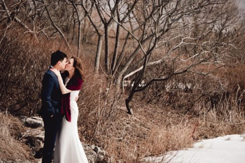 outdoor winter wedding photo of a bride and groom in the woods - photo by photography from the Soul