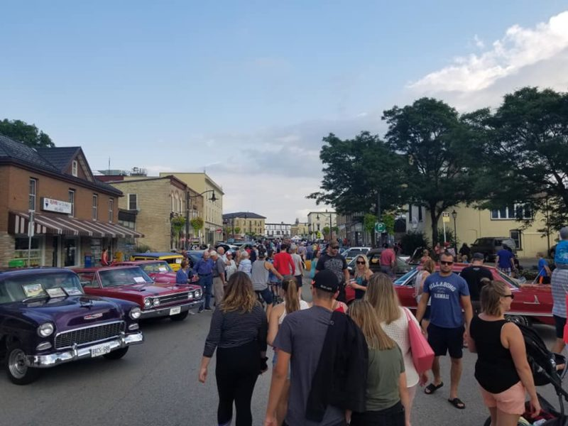 crowds walking along Peel Street in New Hamburg during Cruise Night, part of Sidewalk Sale Days