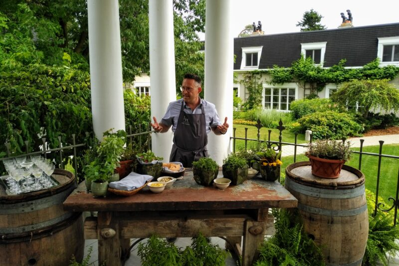 Langdon Hall Executive Chef Jason Bangerter preparing appetizers outdoors on the porch during the summer