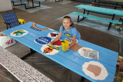 12 year old artist Maia Lynch working on her Art Fresco Public Art Project picnic table at Lot42