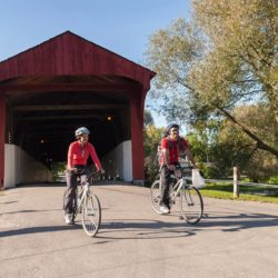 Cyclists at the West Montrose Covered Bridge