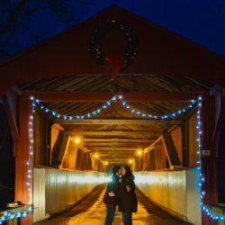 Couple kissing at the West Montrose Covered Bridge