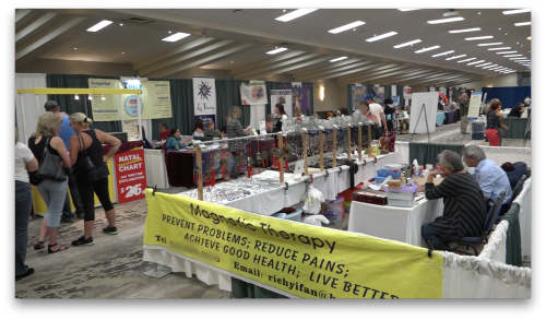 Attendees walking around booths at the K-W Psychic Fair