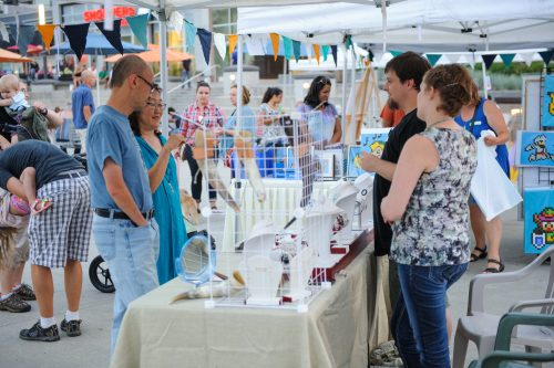outdoor vendors set up in Waterloo Square for Final Fridays