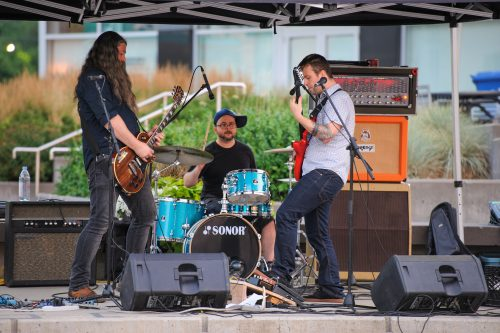 local musicians performing outdoors at Final Friidays