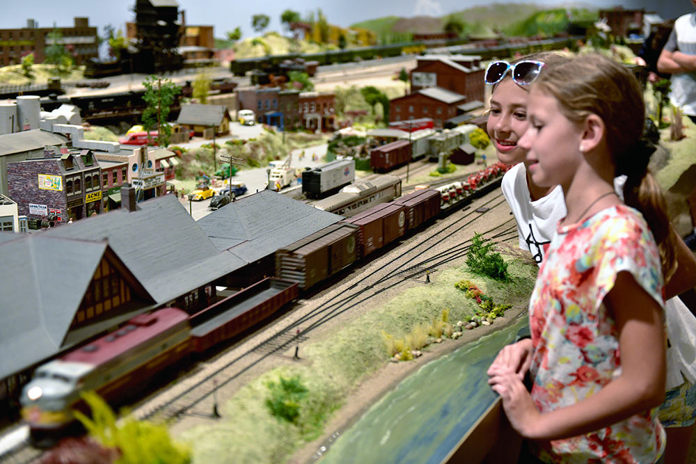 two children watching the model railways in action at St. Jacobs and Aberfolye  Model Railway