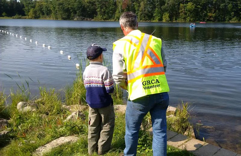 child learning to fish with GRCA instructor