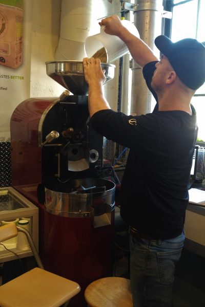 Dan roasting coffee beans at EcoCafe St. Jacobs
