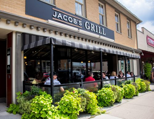 people on the patio at Jacob's Grill in St. Jaobs