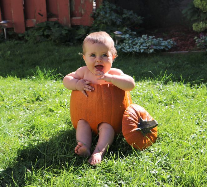 baby in a carved out pumpkin